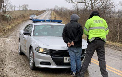Man arrested following rollover crash
