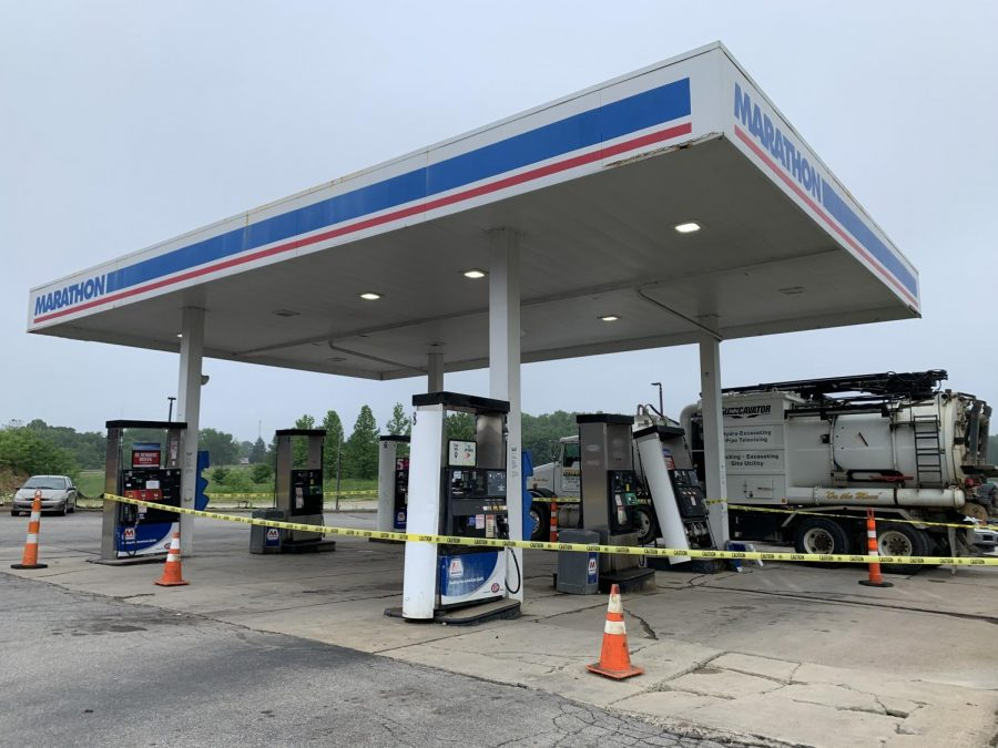 Road closed due to large leak at gas station