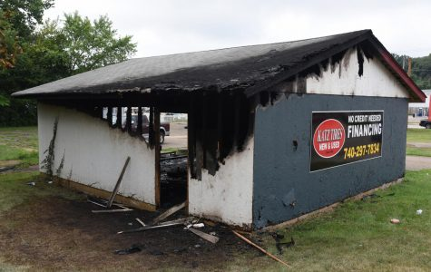Garage catches fire one day after business opens to the public
