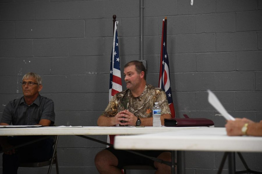 New Roseville Mayor Bryan Stickel (center) speaks to a crowd of citizens at Fridays emergency meeting.