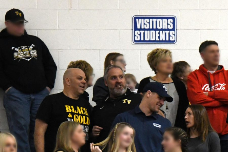 Tri-Valley School Board President Eddie Brock and Superintendent Mark Neal, along with Brocks son, Seth Brock, and daughter-in-law Brooke Brock, a former Tri-Valley teacher, enjoy a basketball game together at West Muskingum High School. Faces of other unaffiliated spectators have been blurred.